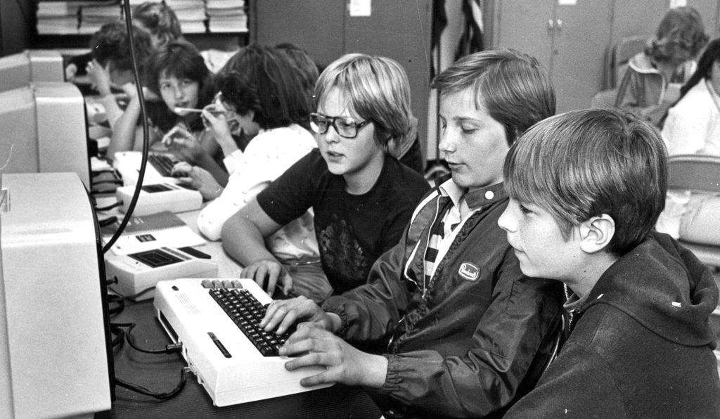Young boys programming on a computer in 1982.