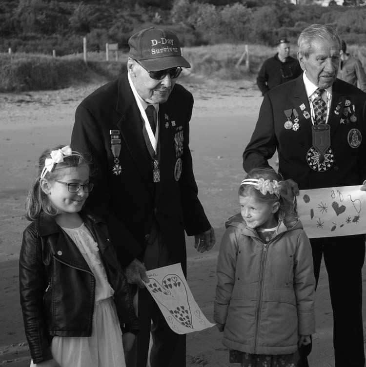Charles Shay and Ray with two local children at Omaha Beach 2018 (c) Ray Lambert.jpg