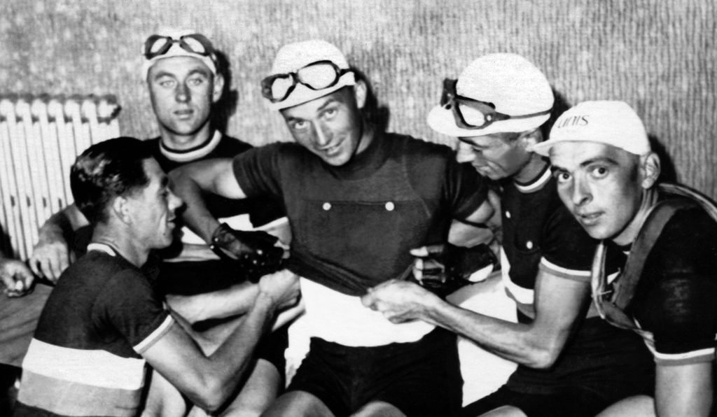 Jean Majerus of Luxembourg puts on the yellow jersey after winning the first stage of the competition, June 30, 1937.