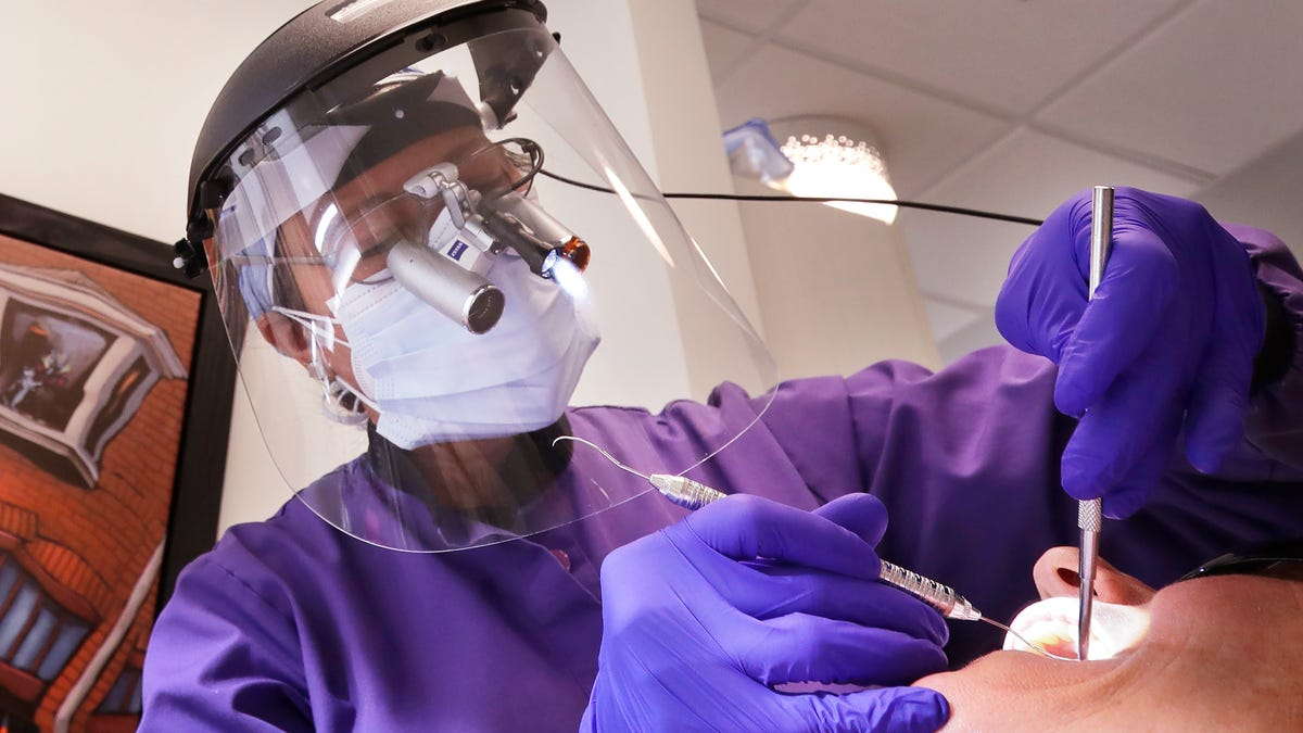 Would you get a COVID-19 vaccine from your dentist? 'Drillers and fillers' fight pandemic